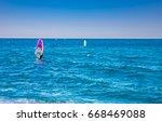 windsurfers on the blue sea | Shutterstock . vector #668469088