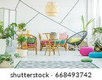 Living Room With Colorful Pouf...