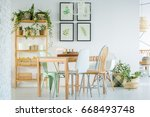 cozy dining room with wooden... | Shutterstock . vector #668493748