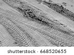 Car Tracks On Sand Road In...
