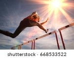 runner jumping over running... | Shutterstock . vector #668533522