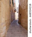 narrow street in mdina malta... | Shutterstock . vector #668534218