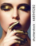 girl with gold make up and gold ... | Shutterstock . vector #668545282