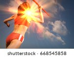female athlete throwing javelin | Shutterstock . vector #668545858