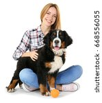 Stock photo young woman with cute funny dog on white background 668556055