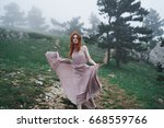 woman in a dress in nature      ...   Shutterstock . vector #668559766