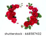 frame of red roses on a white... | Shutterstock . vector #668587432