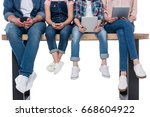 low section of family using... | Shutterstock . vector #668604922
