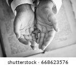 cross in the child's hand. | Shutterstock . vector #668623576