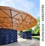 Small photo of LONDON - JUNE 23, 2017. Entrance to the 17th temporary Serpentine Gallery annual Summer Pavilion, designed this year by African architect Francis Kere, in Kensington Gardens, London, UK.