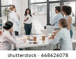 young multiethnic group of... | Shutterstock . vector #668626078