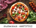 pizza with tomatoes  mozzarella ...   Shutterstock . vector #668737312