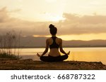 young asian woman practice yoga | Shutterstock . vector #668787322
