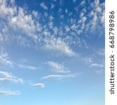 beautiful blue sky with clouds... | Shutterstock . vector #668798986