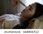 the guy touches a finger to the ... | Shutterstock . vector #668846512