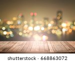 wooden table with city night... | Shutterstock . vector #668863072