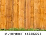 Bright Wooden Fence With Green...