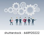 business people group under cog ... | Shutterstock .eps vector #668920222
