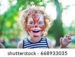 smiling boy with curly hair and ... | Shutterstock . vector #668933035