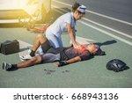 female nurse helping emergency... | Shutterstock . vector #668943136