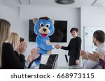 boss dresed as teddy bear... | Shutterstock . vector #668973115