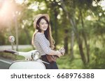 tourist playing ukulele and... | Shutterstock . vector #668976388