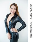 beauty woman in leather overalls | Shutterstock . vector #668976622