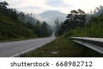 Small photo of Travel along Semenyih Highway with Background Mist and Beautiful Mountains, Selangor, Malaysia.
