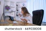 businesswoman taking pill...   Shutterstock . vector #669038008