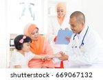 southeast asian kid patient... | Shutterstock . vector #669067132