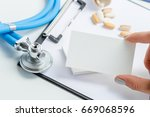 the doctor writes a... | Shutterstock . vector #669068596