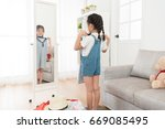 happy young little girl packing ... | Shutterstock . vector #669085495