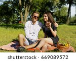 beautiful young couple sitting...   Shutterstock . vector #669089572