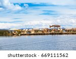 totora boat on the titicaca... | Shutterstock . vector #669111562