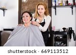 woman is satisfied with work of ... | Shutterstock . vector #669113512