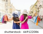 cherfull women with shopping... | Shutterstock . vector #669122086