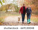mature couple on autumn walk... | Shutterstock . vector #669130048