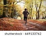 rear view of mature man running ... | Shutterstock . vector #669133762