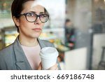 serious or pensive woman with... | Shutterstock . vector #669186748