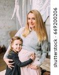 beautiful mother hugging her... | Shutterstock . vector #669200206