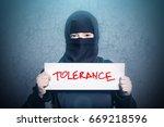 muslim girl in black hijab... | Shutterstock . vector #669218596
