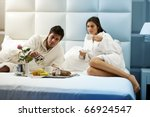 Stock photo relaxed couple in bed hotel room 66924547