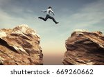 young man jumping over the... | Shutterstock . vector #669260662