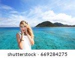 woman enjoy the sun. | Shutterstock . vector #669284275
