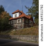 Small photo of Sec, Czech Republic - October 10, 2017 - House of Sec dam operator, beautiful old style stone building, red roof.