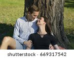 beautiful young couple sitting...   Shutterstock . vector #669317542