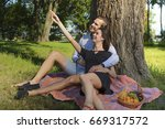 beautiful young couple sitting...   Shutterstock . vector #669317572