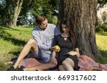 beautiful young couple sitting...   Shutterstock . vector #669317602