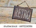 rusty metal sign on wooden... | Shutterstock . vector #669326086