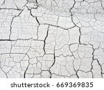 various cracks in the dry clay... | Shutterstock . vector #669369835
